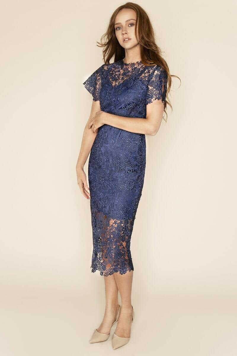 Hannah Guipure Lace Short Sleeved Midi Dress Look no further for the perfect occasion dress this season! Beautifully crafted in dark blue guipure lace that delicately hugs your figure, our Hannah midi dress will showcase your curves in the classiest of ways.