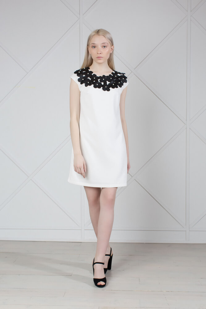 White Mini Dress With Flower Appliques.This mini dress is cut from cream stretch-jersey and lined with viscose and Eco-leather flower appliques.