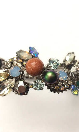 Goldsand Voyager Bracelet made with selection of Swarovski stones in Black diamond, Luminous green and hand enamelled Lilac crystals.