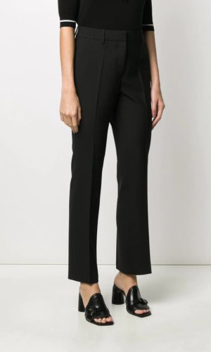 Highlights black virgin wool-blend straight leg tailored cut high rise concealed front fastening side slit pockets two rear welt pockets Made in Italy