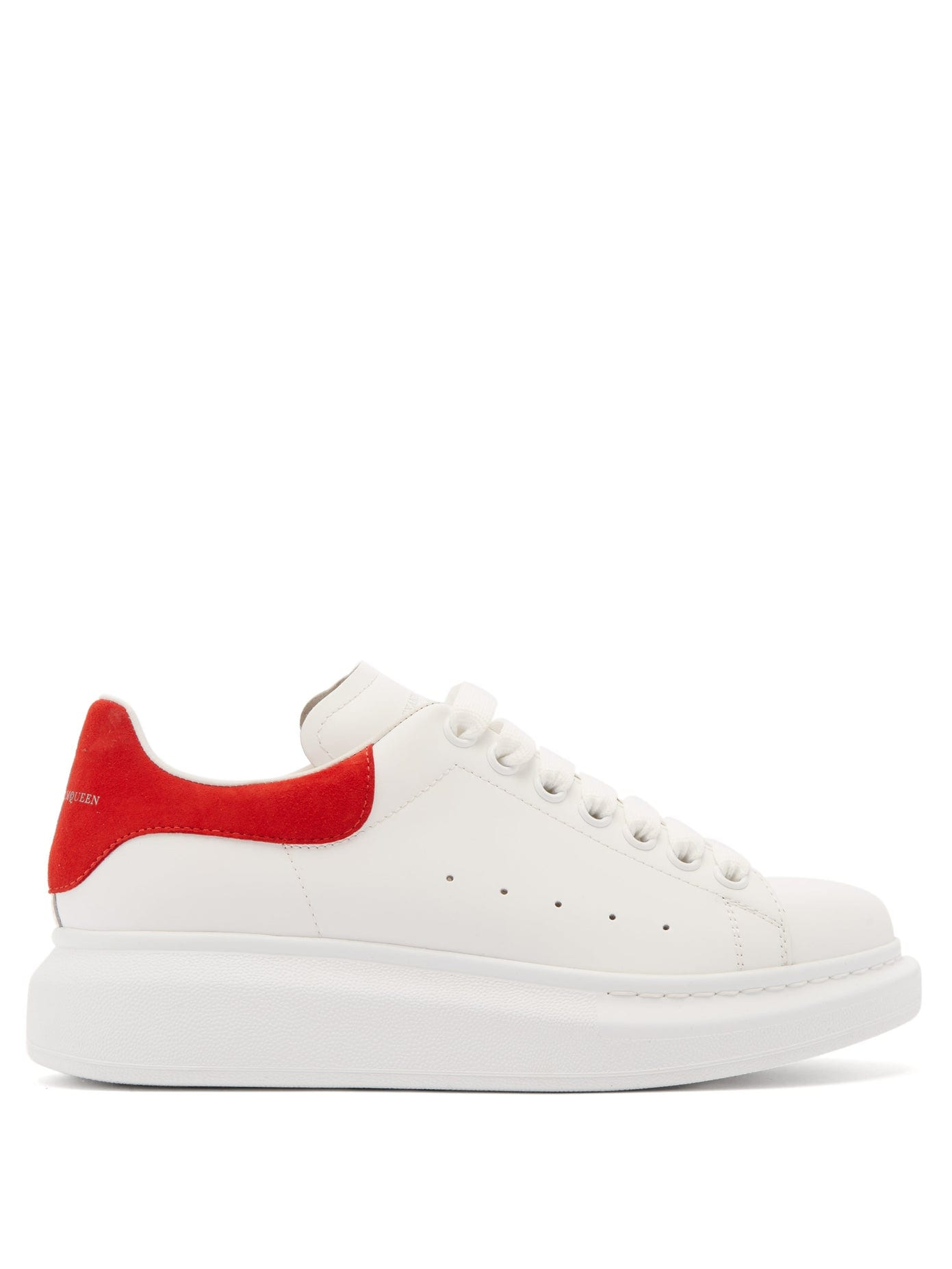 white leather platform sneakers with red heel tab