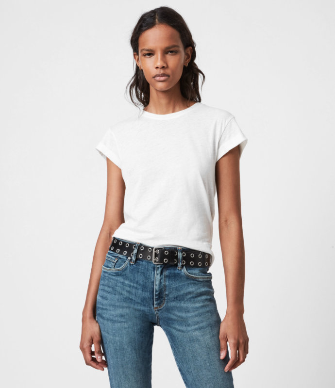 A WOMAN WEARING WHITE T SHIRT AND JEANS