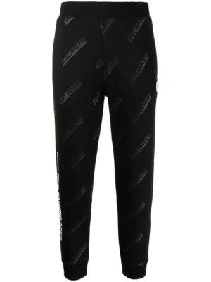 AAPE BY *A BATHING APE® slogan-print skinny track pants - Black