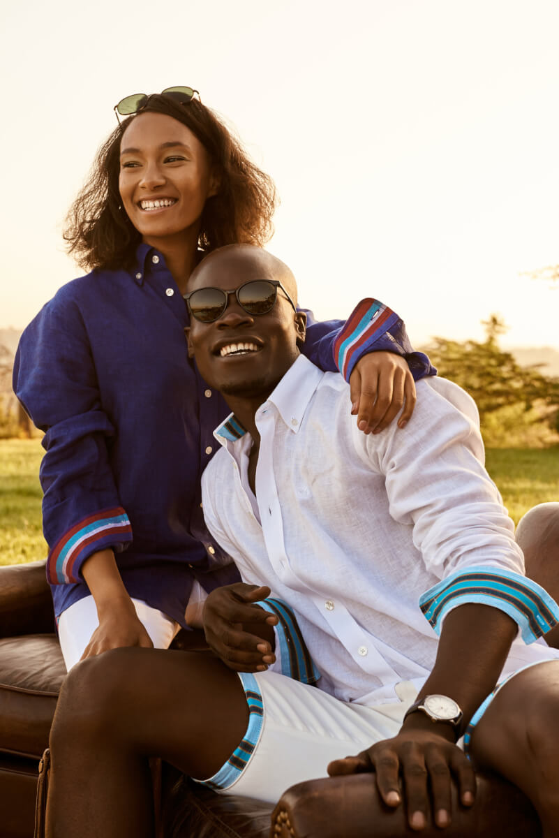 male and female models wearing white and navy blue koy shirts